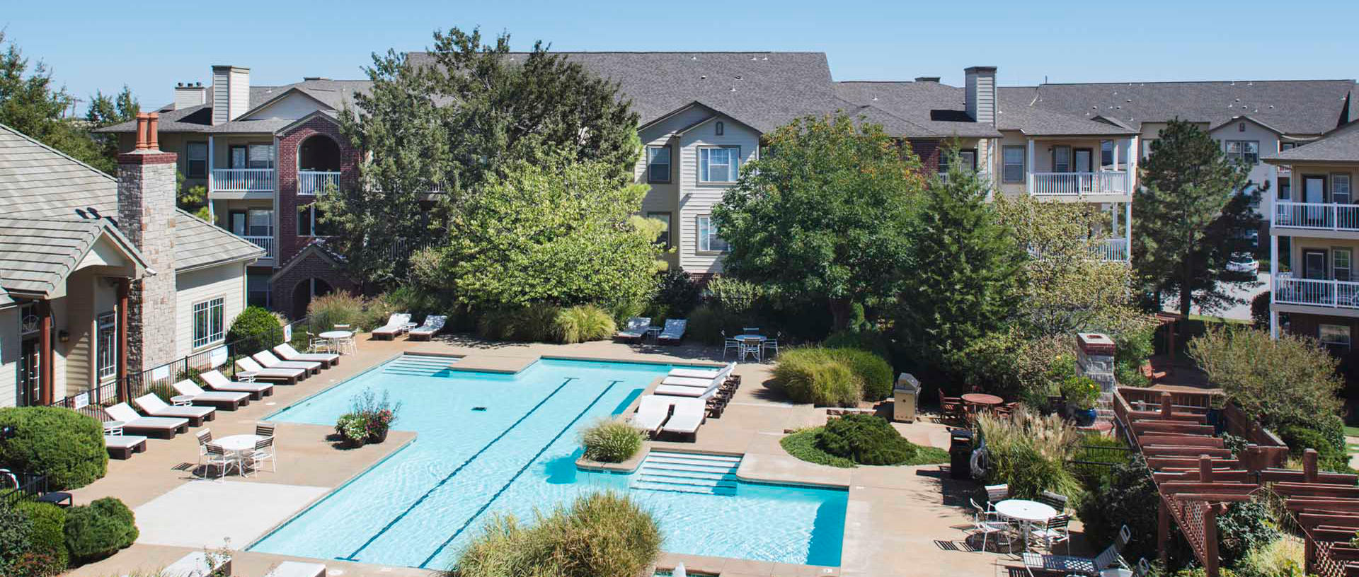 A view of the swimming pool, clubhouse and apartment building at Crown Martin Park Apartments in Oklahoma City, Oklahoma.